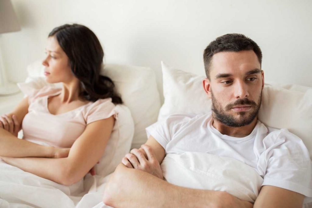 unhappy couple in the bed