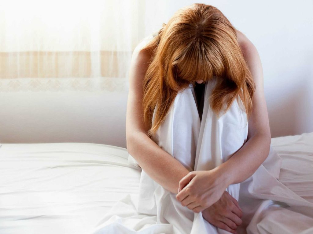 woman is suffering because of painful sex